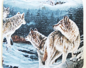 Wolves running in the snow Mousepad