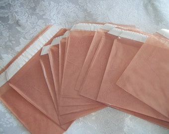 "Garden City Craft and Design Mauve Translucent Poly Envelope pack, 5.75"" x 4.5""."