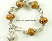 Bracelet of Beige Lampwork Glass Beads