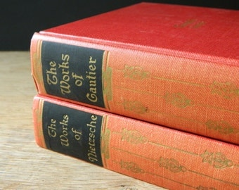 The Works of Nietzsche and Gautier. pair of vintage books in red. classic literature.