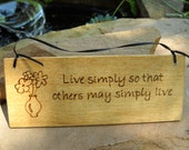 Live simply so that others may simply live wall hanging
