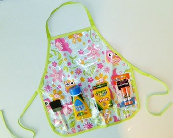 Hoot owl pink and green wipe off vinyl oil cloth school play apron smock with pockets for art supplies for messy projects - kids ages 1 to 6