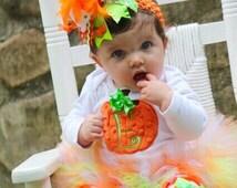 Pumpkin Outfit -- Baby Girl Pumpkin Outfit -- Pretty Little Pumpkin -- bodysuit, tutu, leg warmers and Over The Top bow