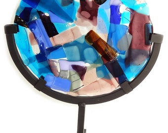 Round glass fusing sculpture incl. standard. An exclusive handmade round glass panel in a variety of purple, pink and blue glass