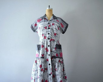 Vintage 1940s dress . 40s button front floral dress