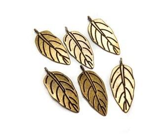 6 bronze leaf charms