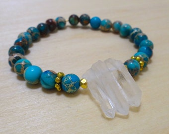 Turquoise Magnesite Beaded Bracelet with Three Crystal Quartz and Gold Spacers