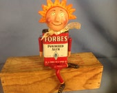 Paper clay sculpted Daisy Ray figure assembled with a vintage spice tin