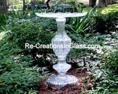 Garden art. Statement piece for grand foyer.  Glass sculpture made with repurposed glass.  Glass totem.