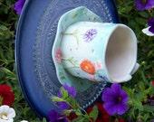 Blue teacup of flowers, flower plate