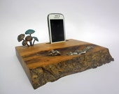 phone stand with small copper mushrooms
