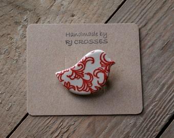 Red ceramic bird brooch