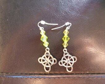 Celtic knot earrings with green glass beads