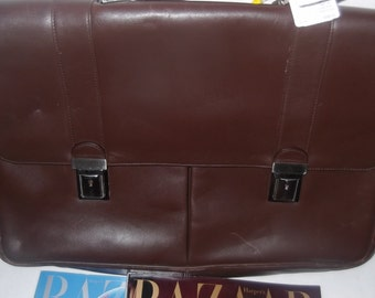 Leather vintage briefcase bought from Marshall Fields original tag still attatched for 325.00 w keys and lots of spacious room, 100% leather