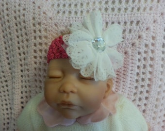 Pink headband with white flower and bling fits newborn to 3 mos