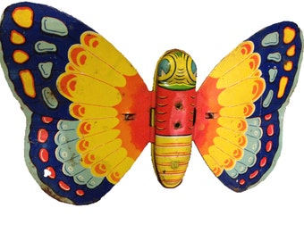 yellow . TOY BUTTERFLY  //  Vintage Metal Butterfly toy with Wheels