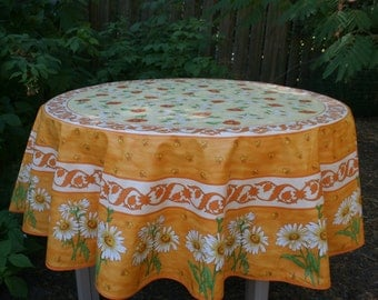 68'' diameter Round tablecloth .oilcloth, cotton coated .Fabric from Provence, France. daisies in orange