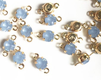 12 pcs of rhinestone 5mm with brass setting  two loop charm-1160-light milky shaphire with gold setting