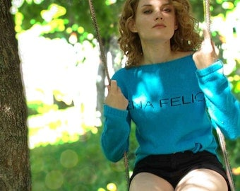 NEW Turquoise Knotted Front Long Back Slogan Sweater