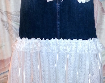 Upcycled denim skirt with lace ruffled bottom and silk flower, delicate lace trim and satin sash.