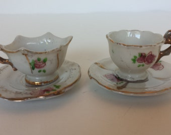 Occupied Japan Child's Cups and Saucers - 2 Sets