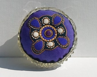 Handmade Felted Wool Purple & Cream Brooch Design on a Purple and Black Pincushion in a Vintage Dish