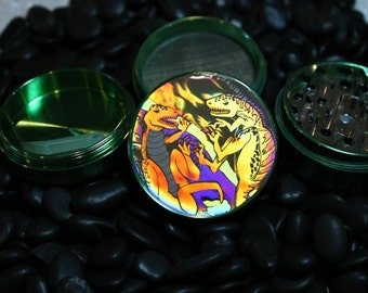 Hologram Dinosaur Fight on a  4 piece herb grinder with plastic scraper