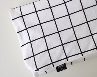 White baby blanket with black grid print