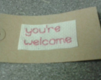 You're welcome - sarcastic stitched gift tag