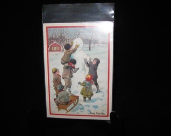 Vintage Christmas postcard Swedish Jenny Nystrom children building a snowman unused