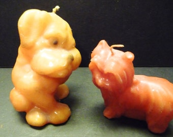 Two Vintage Wax Dog Candles