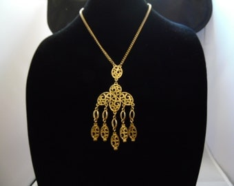 Gold Tone Chains and Pendant with design