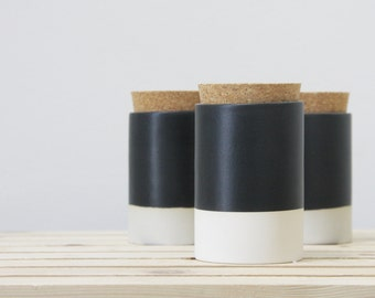 Ceramic jar with a cork lid in white and black matte glaze. Great for christmas gift. modern look for the kitchen