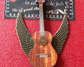 Steampunk inspired 'Ukulele baby' (2)! with silver wings and gears to help those fingers fly, and watch parts to ensure timely arrival.