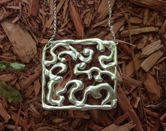 "Sterling silver ""doodle"" pendant"