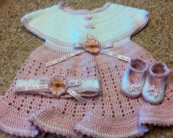 It's A Girl Newborn to Six Months Pink and White Baby Girl Dress, Personalized Headband and Strap Up Mary Jane's Ensemble