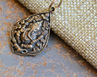 Ganesh Pendant of Bronze, Seated Ganesh, Carved Ganesh, Ganesha, Leaf Shaped Ganesh Pendant, Fine Detail, Remover Of Obstacles, 30x23mm, One