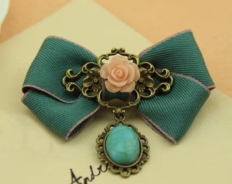 Vintage Style Flower Brooch with green cabochon