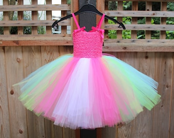 PINK CANDY Tutu Dress. Basic Candyland dress with a pink bodice with bows, adjustable straps and mulicoloured tutu.