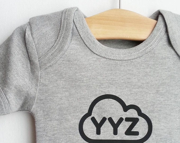 Featured listing image: YYZ airport baby body suit