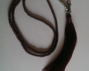 Handmade metal and brown glass bead with tassle necklace.