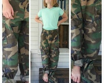 Camouflage military pants / fits 27 inch waist tall Child Teen or Adult XS / six pockets, cinch waist, ankle ties, button fly / Rugged Punk