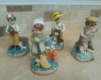 Set of 4. Country Children Figurine