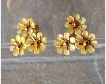 Gold tone yellow bouquet clip on earrings