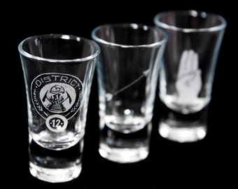 6 x Hunger Games themed Shot glass. Bespoke engraving.
