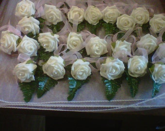 buttonholes pearl and pink ribbon ivory roses