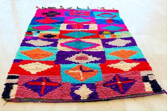 A unique hand loomed beauty Boucherouite rug , rag