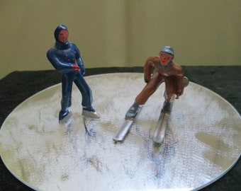 2 Male Vintage Barclay Iron Cast Skater & Skier