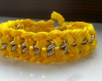 Yellow bracelet with silver chain and woven cotton yarn