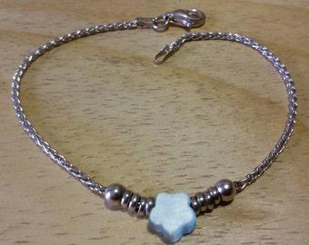Braccialetto in argento 925, italiano, con stella in madreperla azzurra.